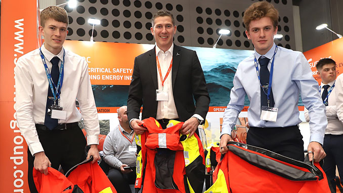 East Coast College students Jack Popple (left) and Connor Langford (right) with Daniel Hawlett-Clarke of Survitec