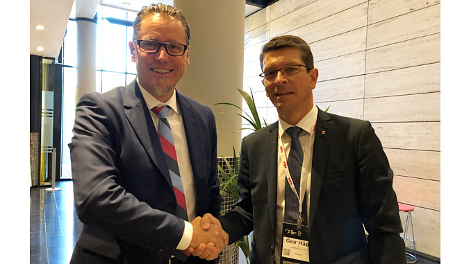 Remi Eriksen, Group President and CEO of DNV GL, with KONGSBERG President and CEO Geir Håøy