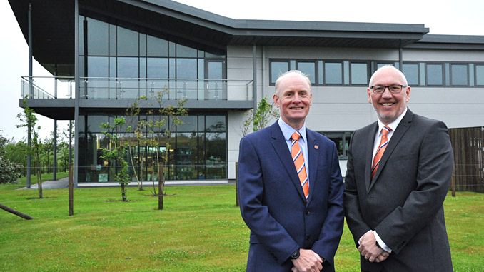 Glenn Wilson, Chief Technical Officer and Graeme Murray, Legal & Commercial Manager outside the new HQ
