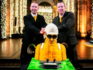 Ready to cut the cake – from left, Malcolm Connolly and Chris Fleming