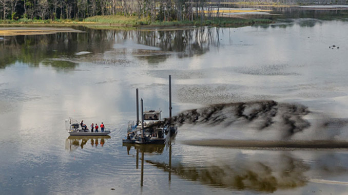At Prime Hook, Wood performed shallow-draft hydraulic dredging to create tidal channels and used historical tidal channel patterns to modify the existing water control structures and allow for free flow of water
