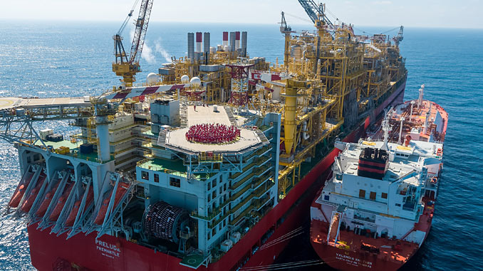 Prelude team wave from the 'Prelude FLNG' facility's helideck, with the 'Valencia Knutsen' berthed side-by-side