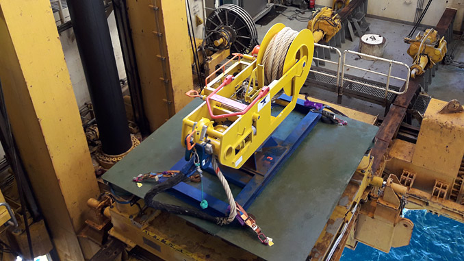 A tensioner component of the TVO Wellhead Fatigue Mitigation System in the moonpool ready for installation