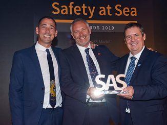 Peter Broadhurst, Senior VP Safety and Security, receiving the award from broadcaster Colin Murray (left) and Guy Platten, Secretary General, International Chamber of Shipping (photo: Inmarsat)