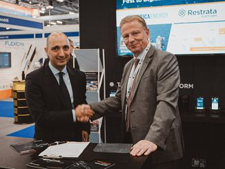 Restrata CEO Botan Osman, left, signs the contract with Serica CEO Mitch Flegg