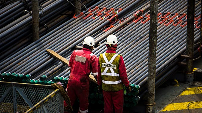 Offshore workers performing roustabout duties
