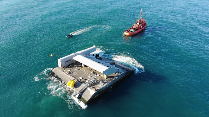 WaveRoller® towed in to position off the coast at Peniche in Portugal
